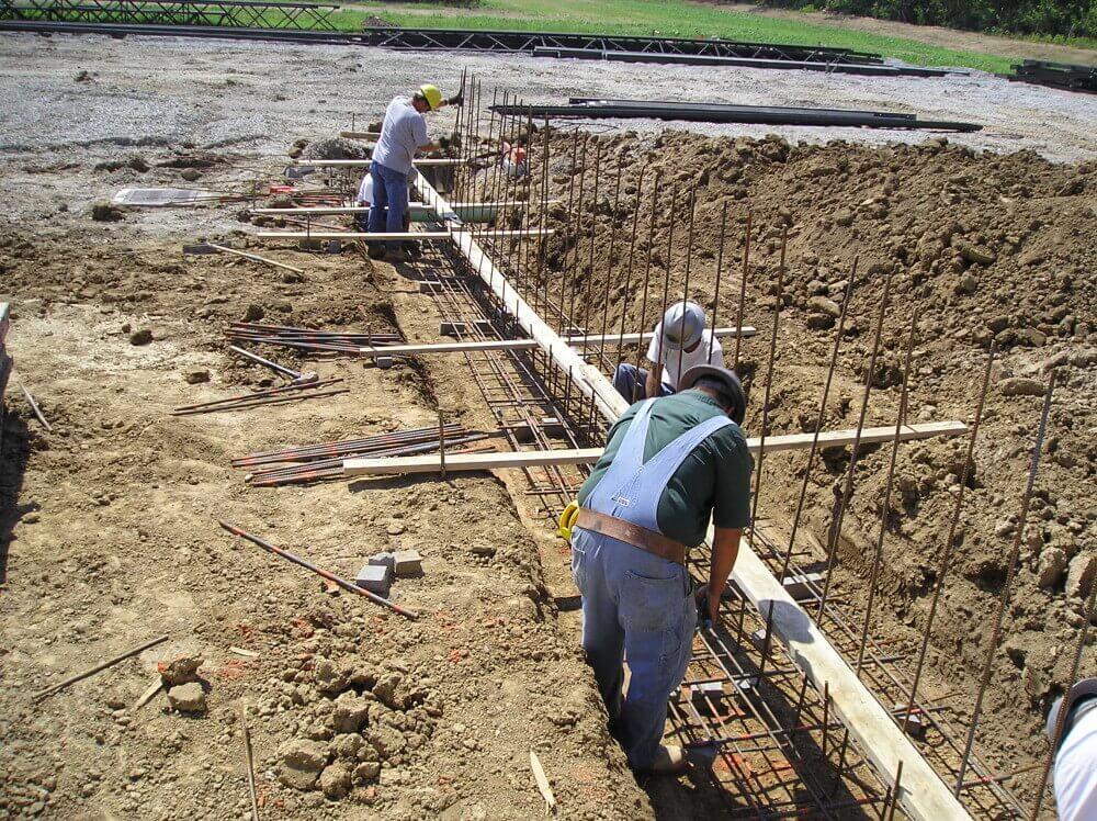 slide 2- Lakoff Construction Digging footers